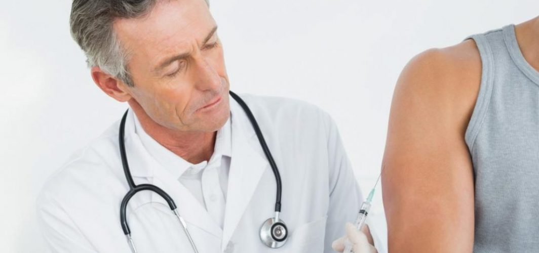 doctor-injecting-a-patients-arm