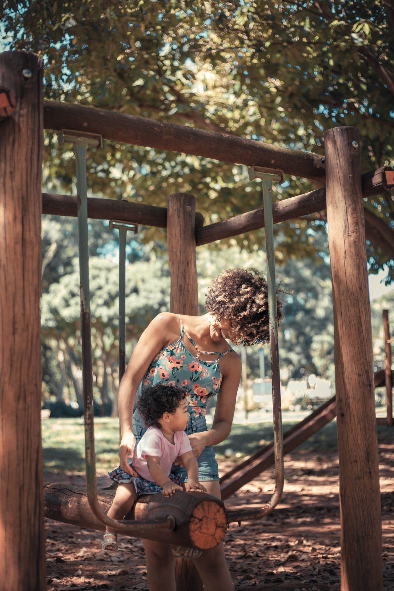 woman with her child on playground