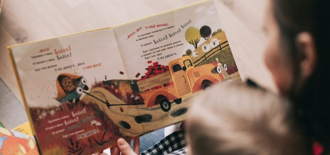 mom reading book to child to develop creativity