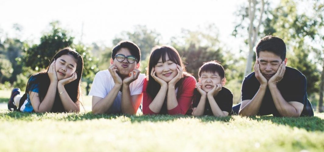 family picture of children and parents relaxing